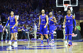 Players Perry Ellis Devonte Graham Landen Lucas and Wayne Selden Jr #1 of the Kansas Jayhawks walks down the court against the Kansas State Wildcats...