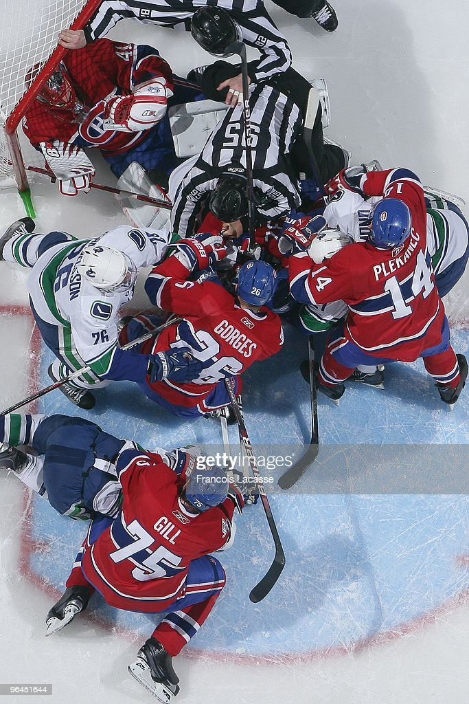 Players piles up in Jaroslav Halak of the Montreal Canadiens net during the NHL game against the Vancouver Canucks on February 2 2010 at the Bell...