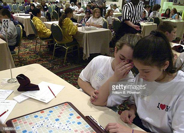 Players plan their moves as they participate in the National School Scrabble Tournament April 26 2003 in Boston Massachusetts More than 200 middle...