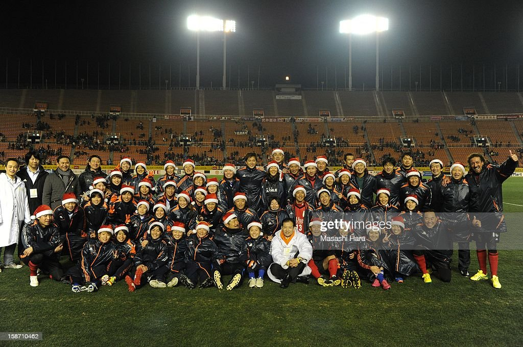 Players pose after the Great East Japan Earthquake charity match 'SAWA and Friends, X'mas Night 2012' at the National Stadium on December 25, 2012 in Tokyo, Japan.