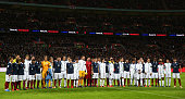 Players pose for a moment of applause prior to the International Friendly match between England and France at Wembley Stadium on November 17 2015 in...