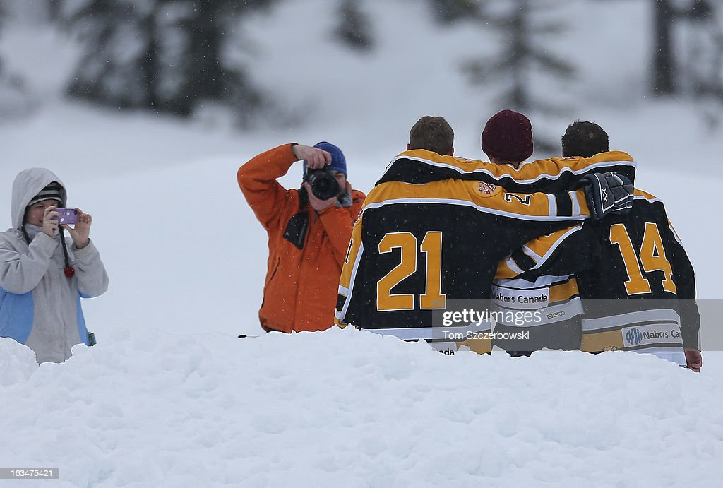 Players pose for a photograph after their outdoor shinny hockey game at the 4th Annual Lake Louise Pond Hockey Classic on the frozen surface of Lake Louise on March 2, 2013 in Lake Louise, Alberta, Canada.