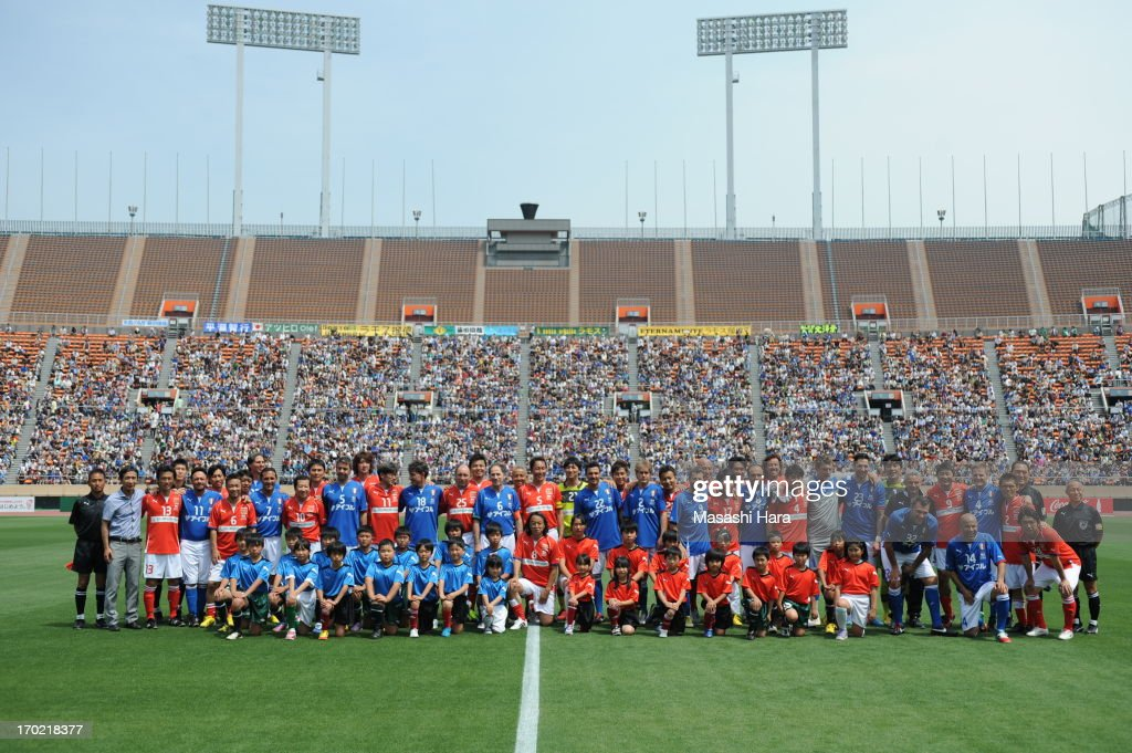 Players pose for a photograph prior to the J.League Legend and Glorie Azzurre match at the National Stadium on June 9, 2013 in Tokyo, Japan.