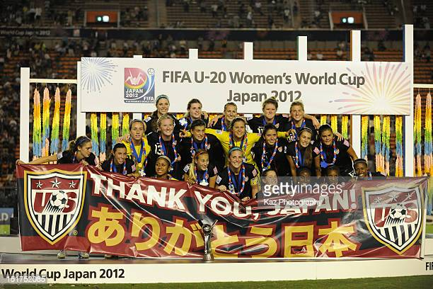 USA players pose for photographs after the FIFA U20 Women's World Cup Final match between USA and Germany at the National Stadium on September 8 2012...