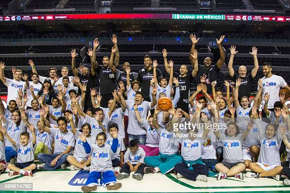 NBA players pose for pictures with Mexican Special Olympics athletes during the NBA Cares clinic at Arena Ciudad de Mexico on December 02 2015 in...