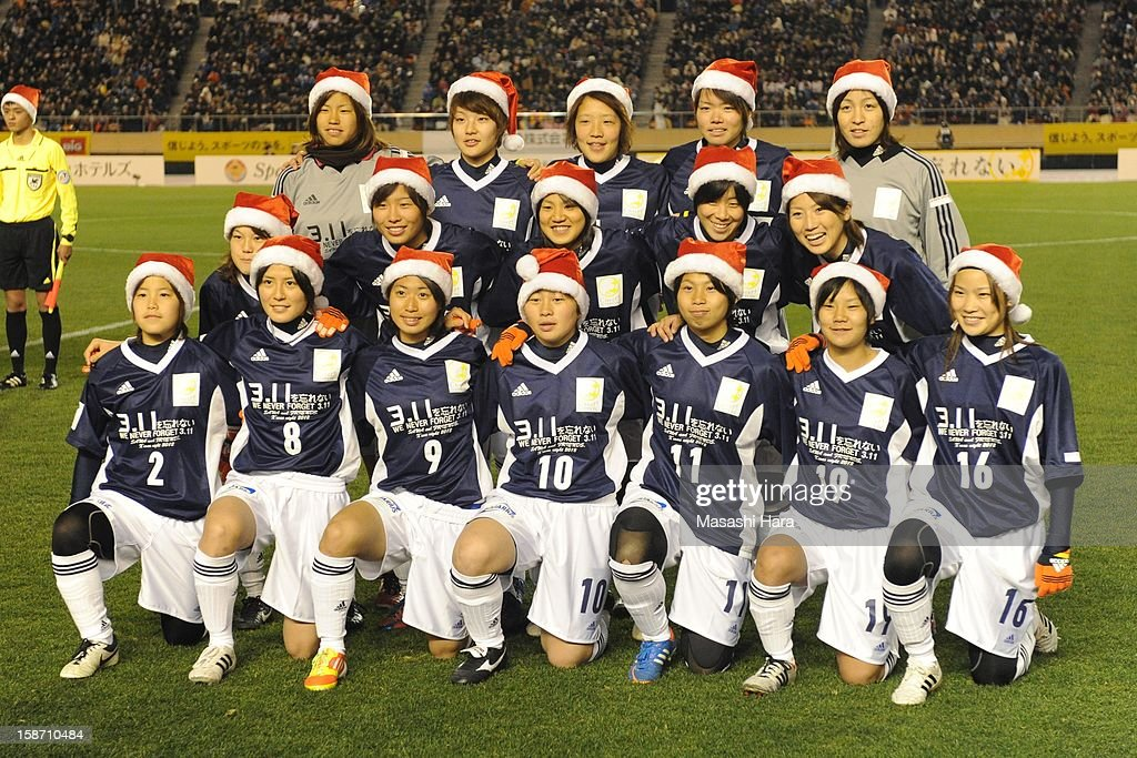 Players pose prior to the Great East Japan Earthquake charity match 'SAWA and Friends, X'mas Night 2012' at the National Stadium on December 25, 2012 in Tokyo, Japan.