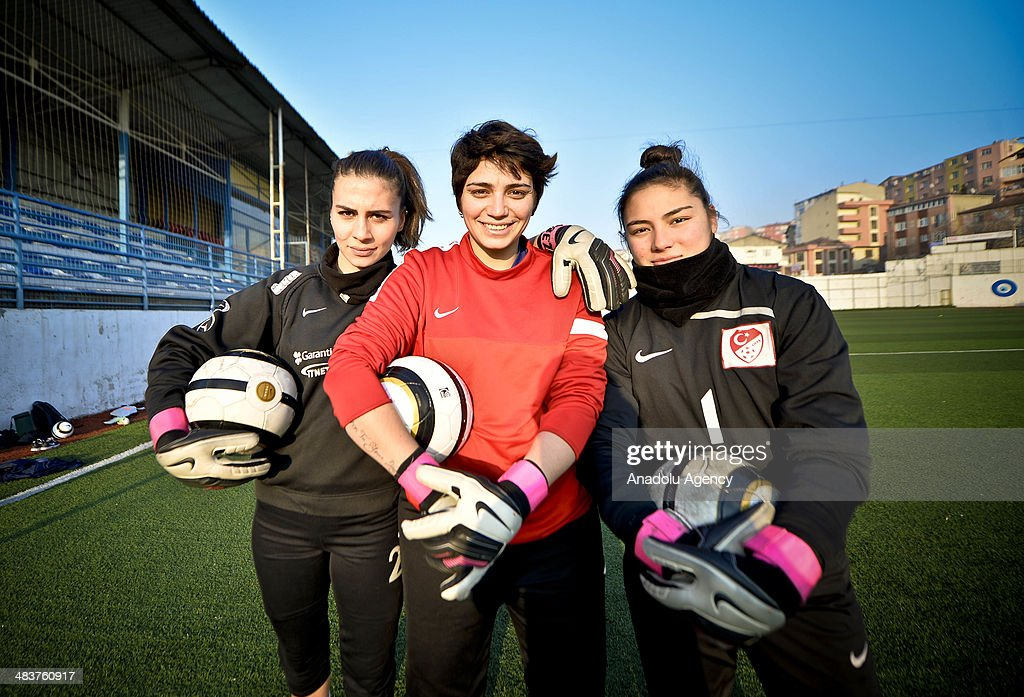 Players pose to camera during the women's training of Atasehir Belediyespor soccer team in Istanbul, Turkey on April 9, 2014. Players of Atasehir Belediyespor in Turkish Women's First Football League, women players play soccer at the same time they continue their education. Women players of soccer team indulging their passion for soccer requires more than just talent and training.