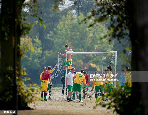 Players preparing the goals for a Sunday League football match on the Racecourse in Northampton England 18th September 2009