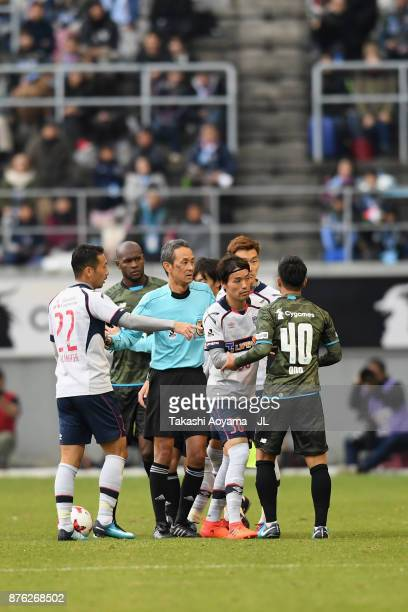 Players protest to referee Itaru Hirose during the JLeague J1 match between Sagan Tosu and FC Tokyo at Best Amenity Stadium on November 18 2017 in...