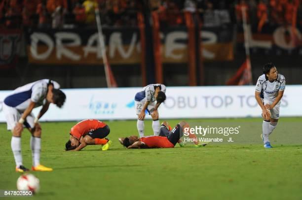 Players react after the 22 draw in the JLeague J1 match between Omiya Ardija and Gamba Osaka at Kumagaya Athletic Stadium on September 16 2017 in...