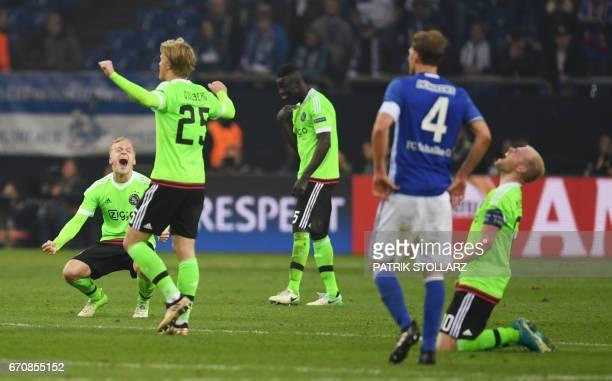 Players react after the UEFA Europa League 2ndleg quarterfinal football match between Schalke 04 and Ajax Amsterdam in Gelsenkirchen western Germany...