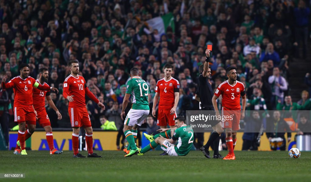 Players react as Neil Taylor of Wales (3) is shown a red card by referee Nicola Rizzoli and is sent off after a challenge on Seamus Coleman of the Republic of Ireland (2) during the FIFA 2018 World Cup Qualifier between Republic of Ireland and Wales at Aviva Stadium on March 24, 2017 in Dublin, Ireland.