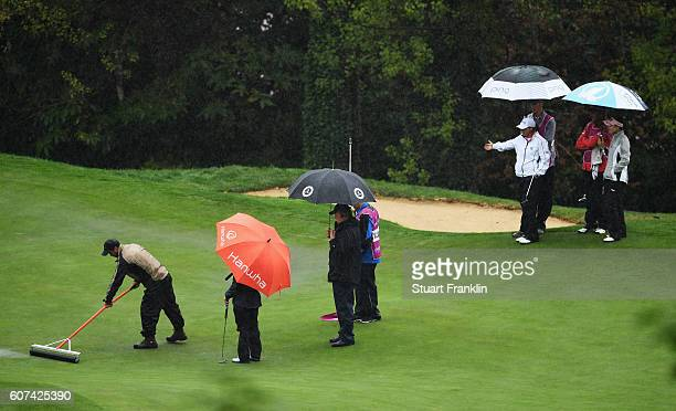 Players react as the greens a squeeged during the final round of The Evian Championship on September 18 2016 in EvianlesBains France