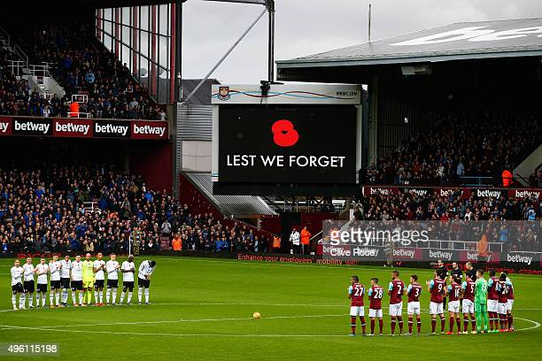 Players remember fallen members of the armed forces ahead of Remembrance Day prior to the Barclays Premier League match between West Ham United and...