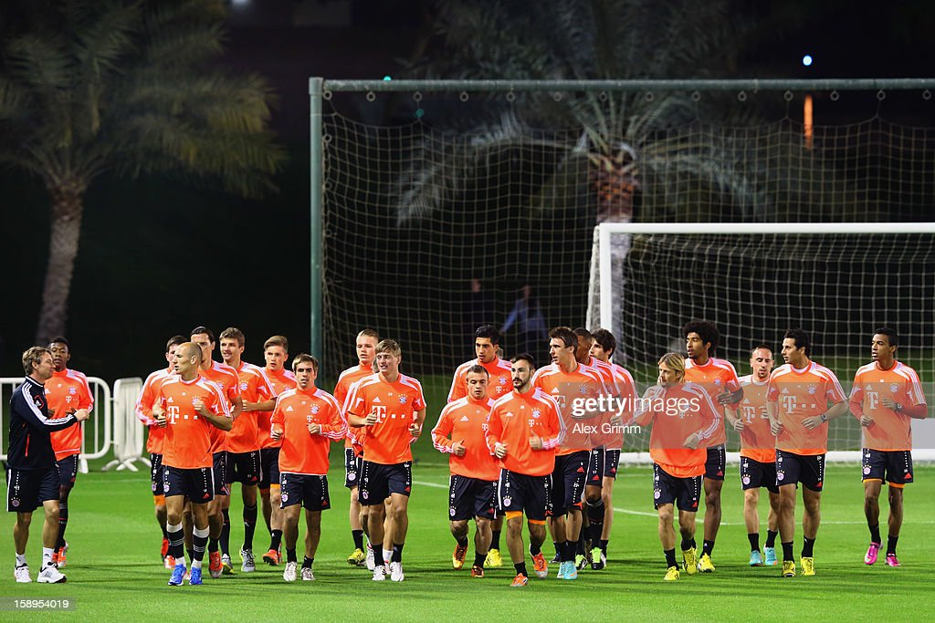 Players run during a Bayern Muenchen training session at the ASPIRE Academy for Sports Excellence on January 4, 2013 in Doha, Qatar.