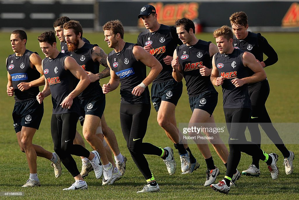 Players run during a Carlton Blues AFL training session at Visy Park on July 2, 2014 in Melbourne, Australia.