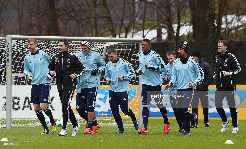 Players run during a Germany training session at 'Kleine Kampfbahn' training ground on March 20, 2013 in Frankfurt am Main, Germany.
