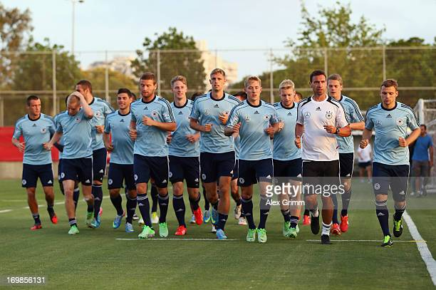 Players run during a Germany U21 training session on June 3 2013 in Tel Aviv Israel