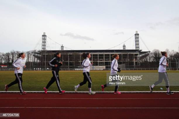 Players run during a performance test of the German women's national team at Sporthochschule on February 6 2014 in Cologne Germany