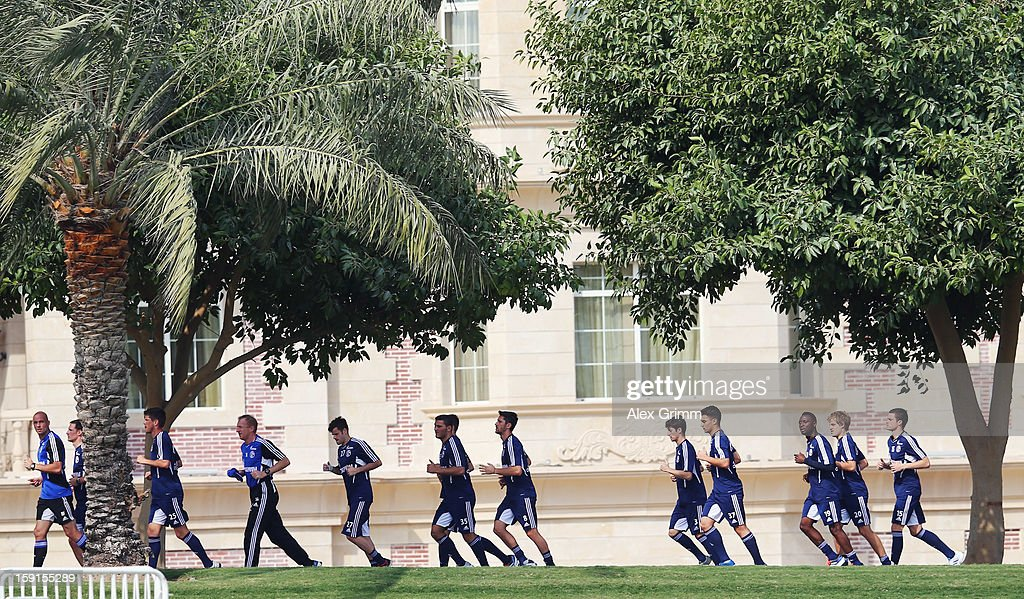Players run during a Schalke 04 training session at the ASPIRE Academy for Sports Excellenceag on January 9, 2013 in Doha, Qatar.