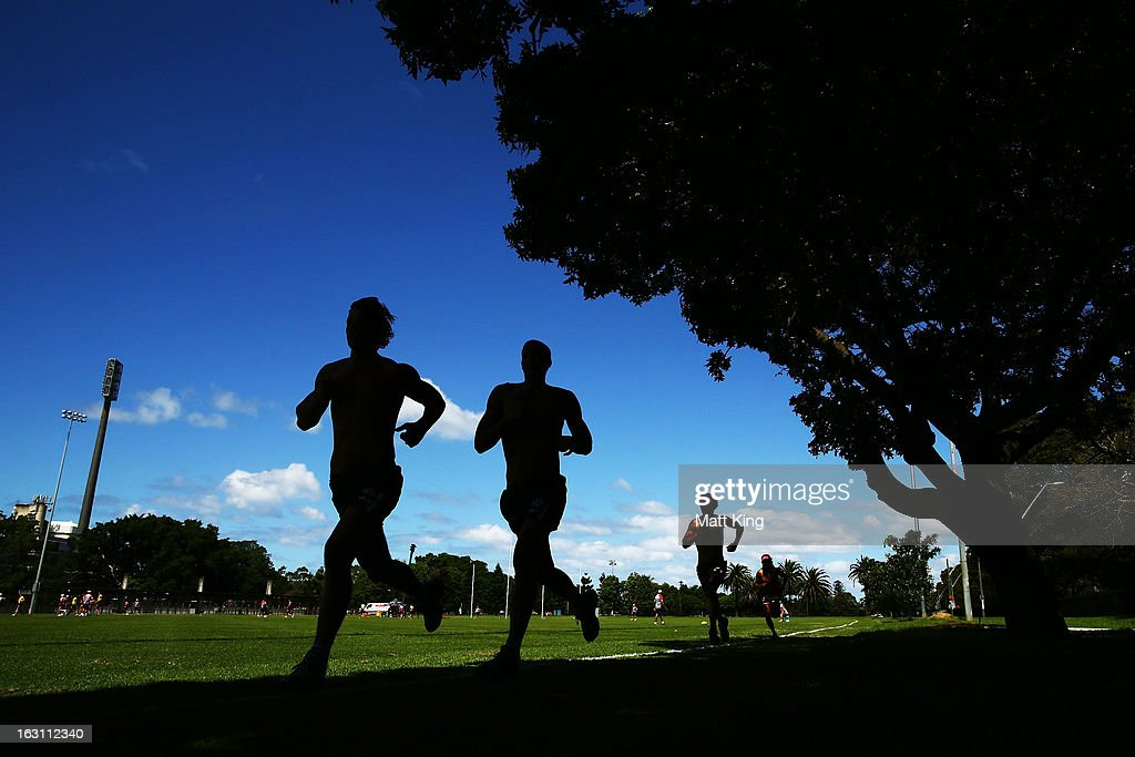 Players run during a Sydney Swans AFL training session at Lakeside Oval on March 5, 2013 in Sydney, Australia.