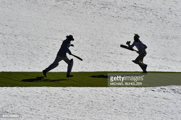 Players run during the 30th Cricket on Ice tournament held on the frozen surface of the Lake St Moritz on February 25 2017 The tournament first took...