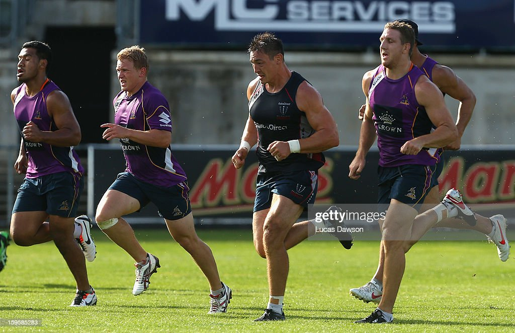 Players run training drills during a Melbourne Storm and Melbourne Rebels training session at Visy Park on January 17, 2013 in Melbourne, Australia.