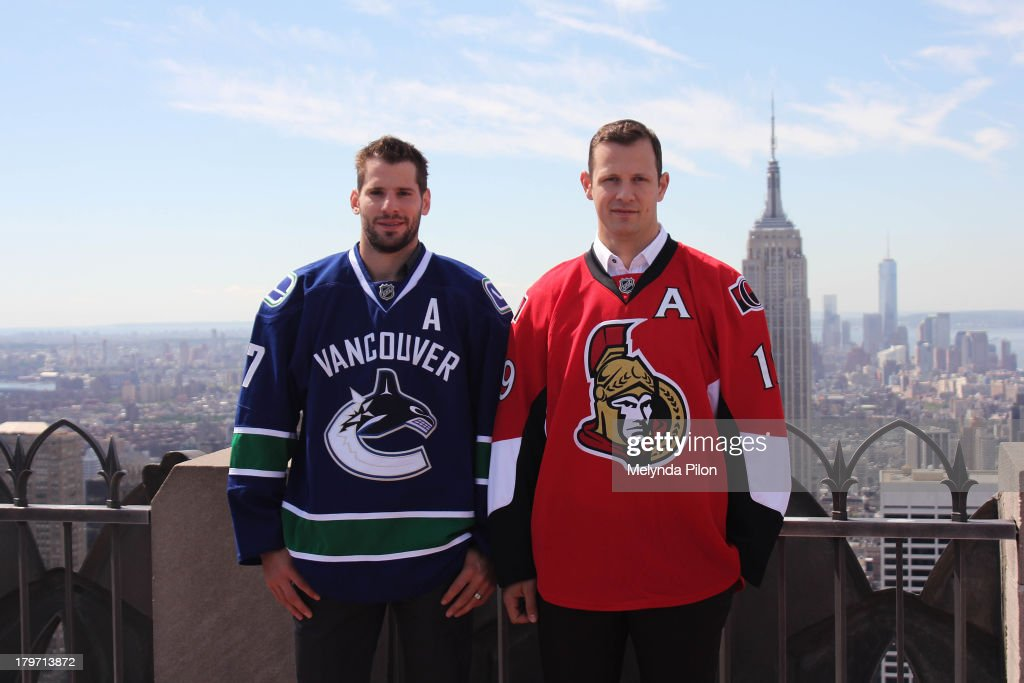 NHL players (L to R) <a gi-track='captionPersonalityLinkClicked' href=/galleries/search?phrase=Ryan+Kesler&family=editorial&specificpeople=206915 ng-click='$event.stopPropagation()'>Ryan Kesler</a> of the Vancouver Canucks and <a gi-track='captionPersonalityLinkClicked' href=/galleries/search?phrase=Jason+Spezza&family=editorial&specificpeople=202023 ng-click='$event.stopPropagation()'>Jason Spezza</a> of the Ottawa Senators visit the Top of the Rock to celebrate the start of the 2013-14 NHL season, including the six regular-season games set to be played in outdoor locations, at the Top of the Rock Observation Deck at Rockefeller Center on September 6, 2013 in New York City.