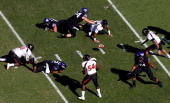 Players scramble for the ball after Trevone Boykin of the TCU Horned Frogs was sacked and fumbled the ball againsts the Texas Tech Red Raiders at...