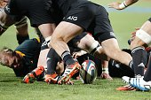 Players scramble for the ball during the final phase of the Four Nations tournament rugby union match between South Africa and New Zealand at Ellis...