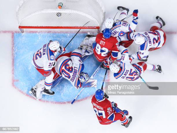 Players scramble in front of goaltender Henrik Lundqvist of the New York Rangers in Game One of the Eastern Conference First Round during the 2017...