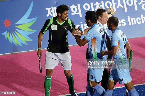 Players scuffle during the men's gold medal match between India and Pakistan on day thirteen of the 2014 Asian Games at Seonhak Hocky Stadium on...