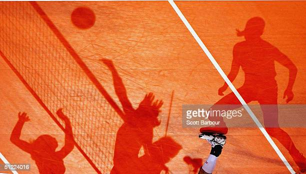 Players shadows are seen on the court during the China v Cuba women's indoor Volleyball semifinal match on August 26 2004 during the Athens 2004...