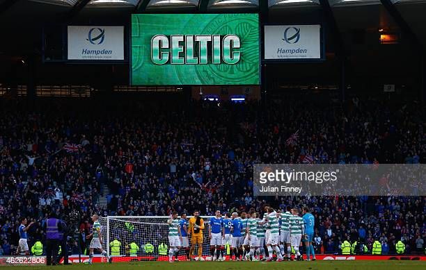 Players shake hand at the final whistle during the Scottish League Cup SemiFinal between Celtic and Rangers at Hampden Park on February 1 2015 in...