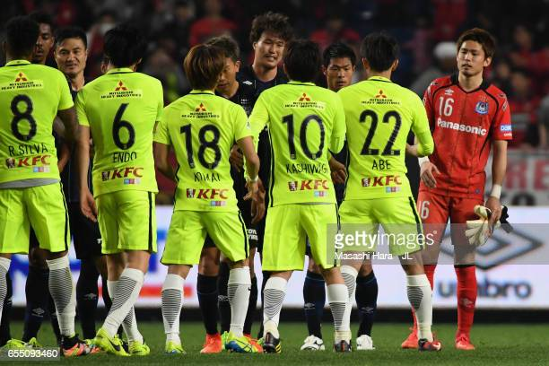 Players shake hands after the 11 draw in the JLeague J1 match between Gamba Osaka and Urawa Red Diamonds at Suita City Football Stadium on March 19...