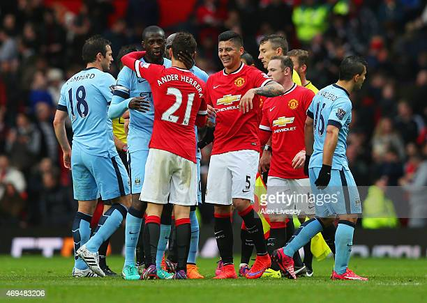 Players shake hands after the during the Barclays Premier League match between Manchester United and Manchester City at Old Trafford on April 12 2015...