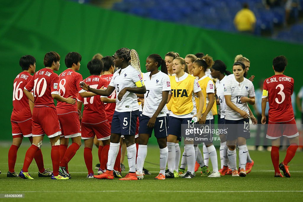 Players shake hands after the FIFA U-20 Women's World Cup Canada 2014 3rd place match between Korea DPR and France at Olympic Stadium on August 24, 2014 in Montreal, Canada.