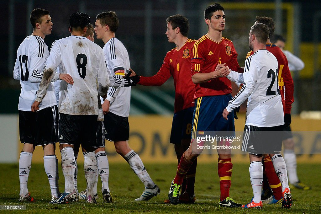 Players shake hands after the International Friendly match between U19 Germany and U19 Spain on March 20, 2013 in Duesseldorf, Germany.
