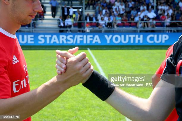 Players shake hands prior to the kickoff on day two of the Blue Stars/FIFA Youth Cup 2017 at the Buchlern sports complex on May 25 2017 in Zurich...