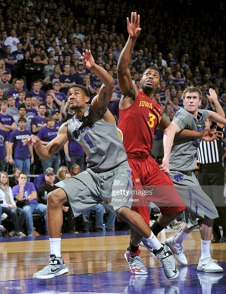 Players Shane Southwell #1 and Will Spradling #55 of the Kansas State Wildcats get position against forward Melvin Ejim #3 of the Iowa State Cyclones for a rebound during the second half on February 9, 2013 at Bramlage Coliseum in Manhattan, Kansas.