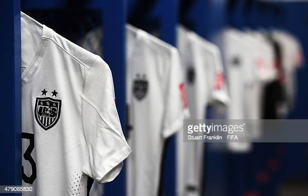 Players shirts hang in the dressing room of USA prior to the FIFA Women's World Cup Semi Final match between USA and Germany at Olympic Stadium on...