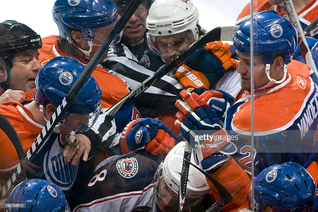 Players shove at each other during a scrum between the Edmonton Oilers and the Columbus Blue Jackets at Rexall Place on March 3, 2011 in Edmonton, Alberta, Canada.