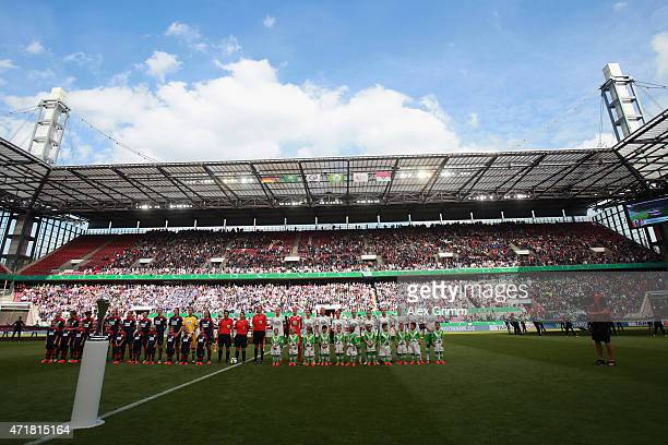 Players sing the national anthem prior to the Women's DFB Cup Final between Turbine Potsdam and VfL Wolfsburg at RheinEnergieStadion on May 1 2015 in...