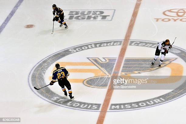 Players skate over the Blues' 50th anniversary logo during warm ups before a NHL game between the Minnesota Wild and the St Louis Blues on November...