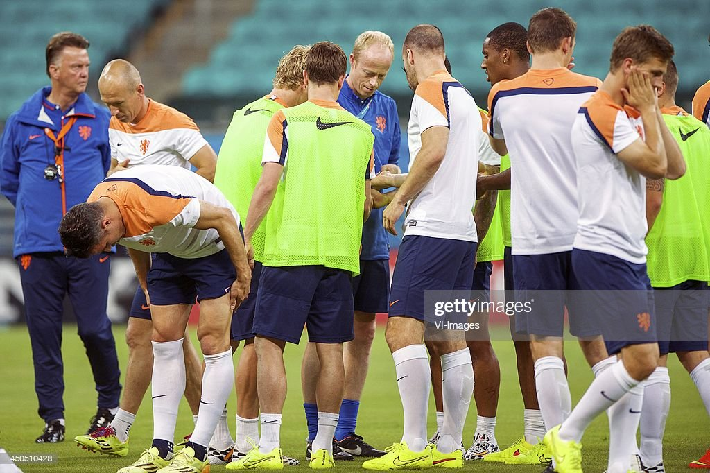 players smear themselves with anti-mosquito cream during a training session of The Netherlands on June 12, 2014 at the Arena Fonta Nova in Salvador, Brazil.