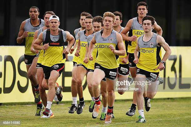 Players sprint half a lap during a StKilda Saints AFL training session at Linen House Oval on November 5 2014 in Melbourne Australia