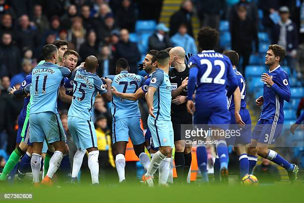 Players squre off after David Luiz of Chelsea is fouled by Sergio Aguero of Manchester City during the Premier League match between Manchester City...