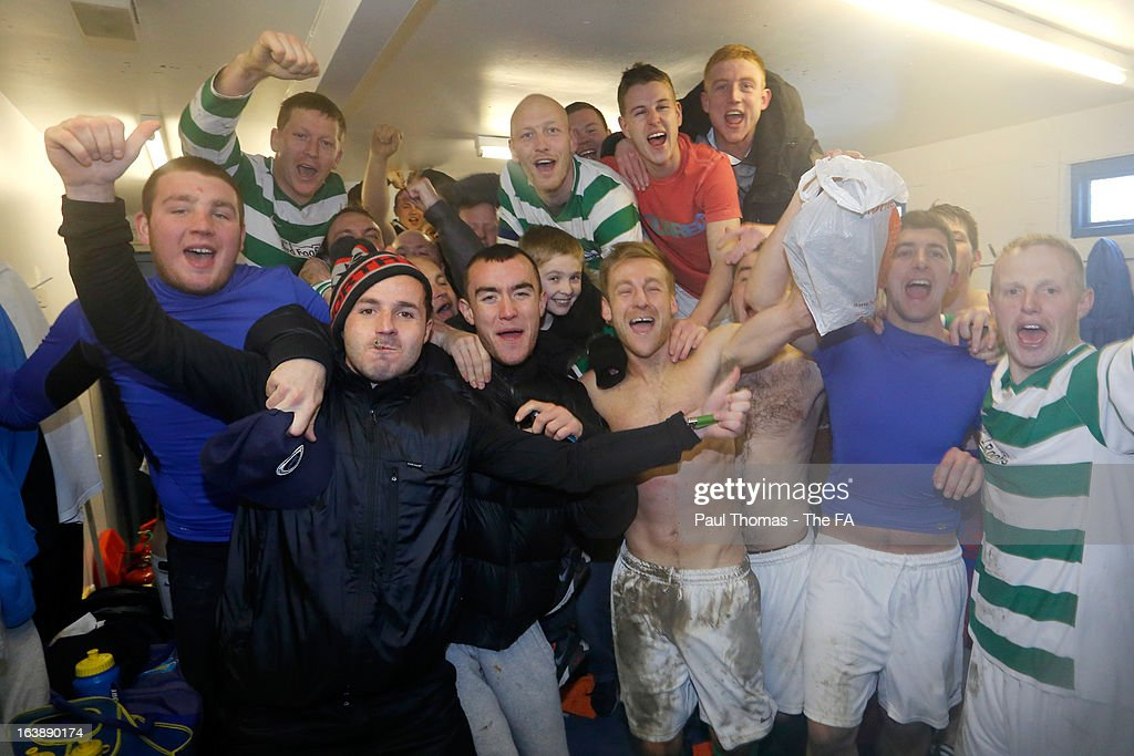 Players, staff and fans of Oyster Martyrs celebrate at full time inside the dressing room after The FA Sunday Cup Semi Final match between HT Sports v Oyster Martyrs at Nethermoor Park on March 17, 2013 in Guiseley, England.