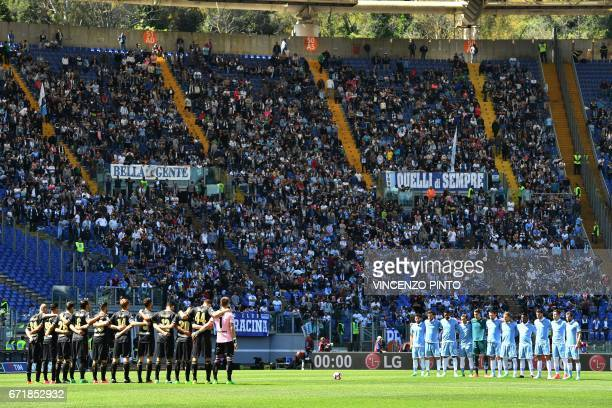 Players stand a minutes silence for Michele Scarponi the 2011 Giro dItalia winner who was killed while cycling near his home yesterday before the...