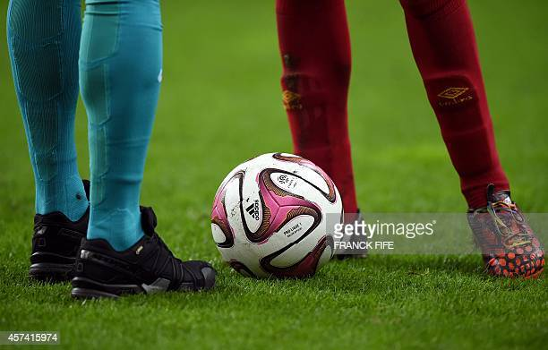 Players stand around the ball during the French L1 football match between RC Lens and Paris SaintGermain on October 17 2014 at the Stade de France in...